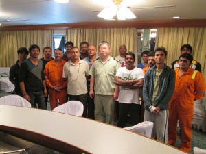 Photo caption : EVER SUMMIT's Captain Horng, Tsong-Been (middle) together with the rescued Indian seafarers